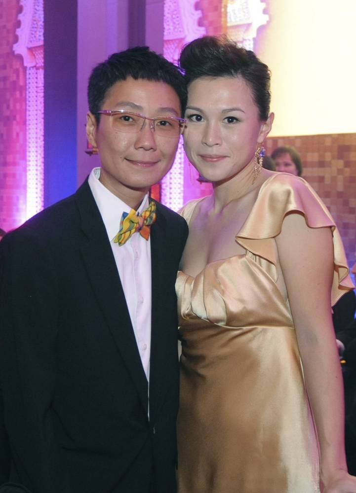 In this undated photo, Gigi Chao, right, daughter of the Hong Kong property tycoon Cecil Chao, poses with her partner Sean Eav at an event in Hong Kong. The daughter of the prominent Hong Kong tycoon who has offered $65 million to any man who can woo her away from her lesbian partner says she's not upset with her father. Gigi says sheís on ìvery loving termsî with her father. He made world headlines this week when he offered the 500 million Hong Kong dollar marriage bounty after learning that his daughter had eloped with her partner to France. (AP Photo)